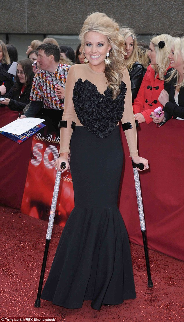 Kelly-Marie, pictured at the British Soap Awards in 2010, was diagnosed with Guillain-Barre syndrome when she was 21, which left her paralysed from the waist down. She has since built up enough strength to walk using crutches