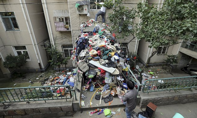 Chinese hoarder collected enough rubbish to block the entrance to a residential area