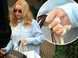 Picture Shows: Iggy Azalea  September 09, 2015\n \n Rapper Iggy Azalea visited Epione in Beverly Hills to get her hand tattoo removed.\n \n Non-Exclusive\n UK RIGHTS ONLY\n \n Pictures by : FameFlynet UK © 2015\n Tel : +44 (0)20 3551 5049\n Email : info@fameflynet.uk.com