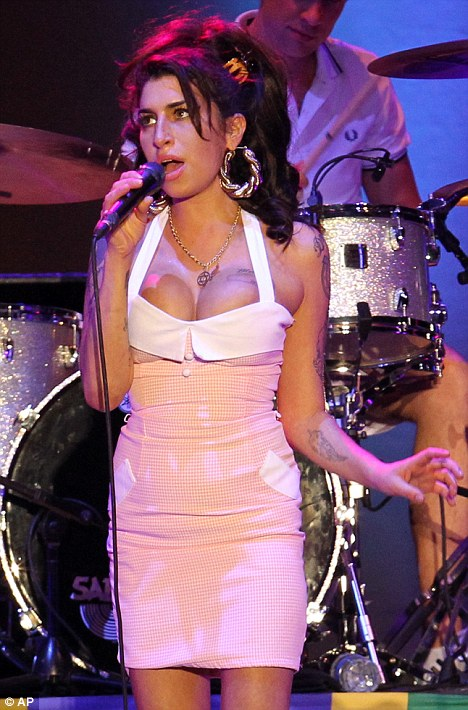 Comeback: Amy, pictured in Rio in January, is back to performing