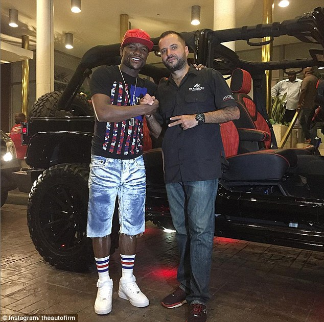 Mayweather posed for a photo withAlex Vega - the guru behindThe Auto Firm in Miami - in front of his Jeep