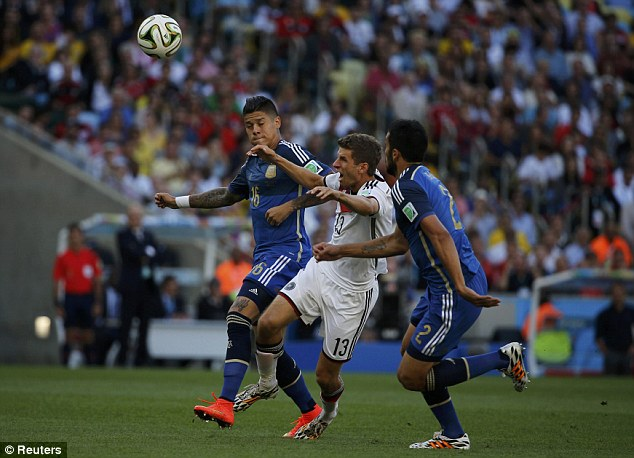 No way through: Muller is challenged by Argentinian defensive pair Marcos Rojo (left) and Garay