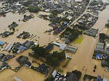 An aerial view shows residential areas flooded by the Kinugawa river (top), caused by typhoon Etau in Joso, Ibaraki prefecture, Japan, in this photo taken by Kyodo September 10, 2015. Japan's weather agency extended its emergency warnings from the Tochigi Prefecture to Ibaraki, after severe rainfall caused floods and landslides on Thursday in eastern Japan, according to local media.  Mandatory credit REUTERS/KyodoATTENTION EDITORS - FOR EDITORIAL USE ONLY. NOT FOR SALE FOR MARKETING OR ADVERTISING CAMPAIGNS. THIS IMAGE HAS BEEN SUPPLIED BY A THIRD PARTY. IT IS DISTRIBUTED, EXACTLY AS RECEIVED BY REUTERS, AS A SERVICE TO CLIENTS. MANDATORY CREDIT. JAPAN OUT. NO COMMERCIAL OR EDITORIAL SALES IN JAPAN.