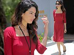 """Human rights lawyer Amal Clooney leaves the Maafushi Prison in Maafushi, some 27 km from the capital Male, on September 10, 2015. Human rights lawyer Amal Clooney attended a court hearing September 10 in the Maldives where state prosecutors have done a U-turn to appeal the conviction of former president Mohamed Nasheed. Clooney was at the Maldivian High Court along with Nasheed who is serving a 13-year jail term after a rushed trial that found him guilty of """"terrorism."""" The charge relates to the ordering of the arrest of an allegedly corrupt judge when Nasheed was still president in 2012. AFP PHOTO / STRSTR/AFP/Getty Images"""