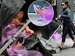 NEW YORK, NY - SEPTEMBER 10:  Kim Kardashian walks Baby North West  to Soho Gym on September 10, 2015 in New York City.  (Photo by Raymond Hall/GC Images)
