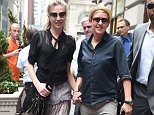 EXCLUSIVE: Ellen Degeneres and Portia De Rossi out for a walk hand in hand in NYC.  Pictured: Ellen Degeneres and Portia De Rossi Ref: SPL1121457  090915   EXCLUSIVE Picture by: Ron Asadorian / Splash News  Splash News and Pictures Los Angeles: 310-821-2666 New York: 212-619-2666 London: 870-934-2666 photodesk@splashnews.com