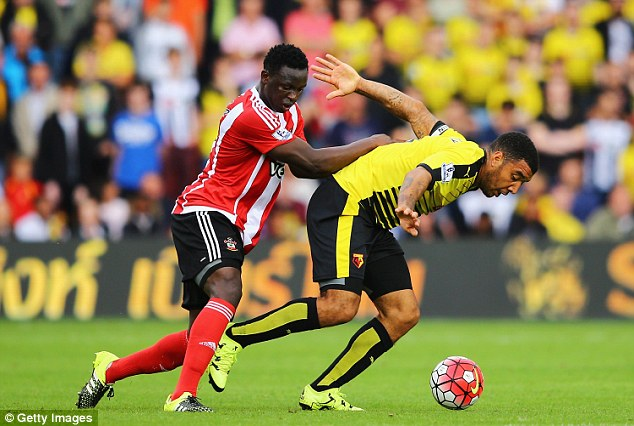Wanyama (left) is on £40,000 a week at Southampton and has two years left on his contract at the club