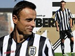 PAOK's new  Bulgarian foward Dimitar Berbatov poses during his presentation at the Toumpa Stadium in Thessaloniki on September 3, 2015. Berbatov has signed to play for one season with PAOK, the Greek Super League club announced on September 3, 2015.  AFP PHOTO / SAKIS MITROLIDISSAKIS MITROLIDIS/AFP/Getty Images
