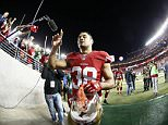 In this photo taken with a fisheye lens, San Francisco 49ers running back Jarryd Hayne (38) waves to fans after an NFL preseason football game against the San Diego Chargers in Santa Clara, Calif., Thursday, Sept. 3, 2015. The 49ers won 14-12. (AP Photo/Tony Avelar)