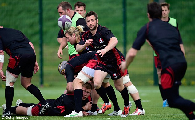 Gloucester scrum half Laidlaw fires out a pass during his side's training session at Hartpury College