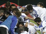 San Marino's Mateo Vitaioli (on ground) and his teammates celebrates his scoring during their Euro 2016 group E qualification match against Lithuania in Vilnius, Lithuania, September 8, 2015. REUTERS/Ints Kalnins