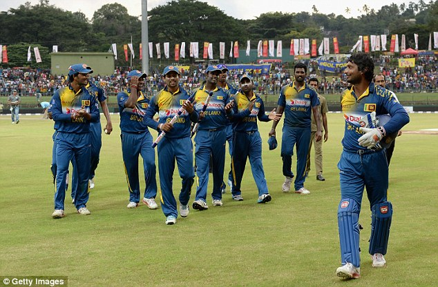 The keeper-batsman's team-mates ensure their veteran leads them off the field after clinching the series