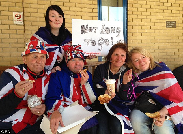 Breakfast: Royal fans (from left) Terry Hutt, John Loughry, Kathy Martin, Maria Scott and Amy Thompson (at the back) enjoy pastries sent to them by Kensington Palace, as they wait outside the Lindo Wing