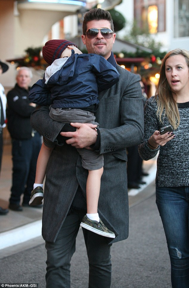 Christmas shopping: The Blurred Lines singer brought his son Julian along for some holiday shopping in West Hollywood