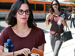 Friends star Courtney Cox wore a maroon shirt and gray jeans for lunch in Beverly Hills,  with friends, on Wednesday, September 9, 2015 X17online.com