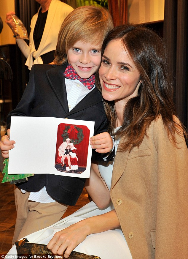 Traditions that moms hold dear: True Detective newcomer Abigail Spencer hugged her son Roman who shared his picture with Santa Claus