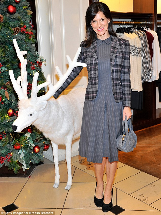 Holiday 'entourage': Perrey Reeves sidled up to a white reindeer prop at the Christmas tree