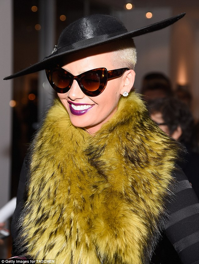 Ms. Divine: Amber swamped her sheer and black paneled dress with a furry chartreuse wrap