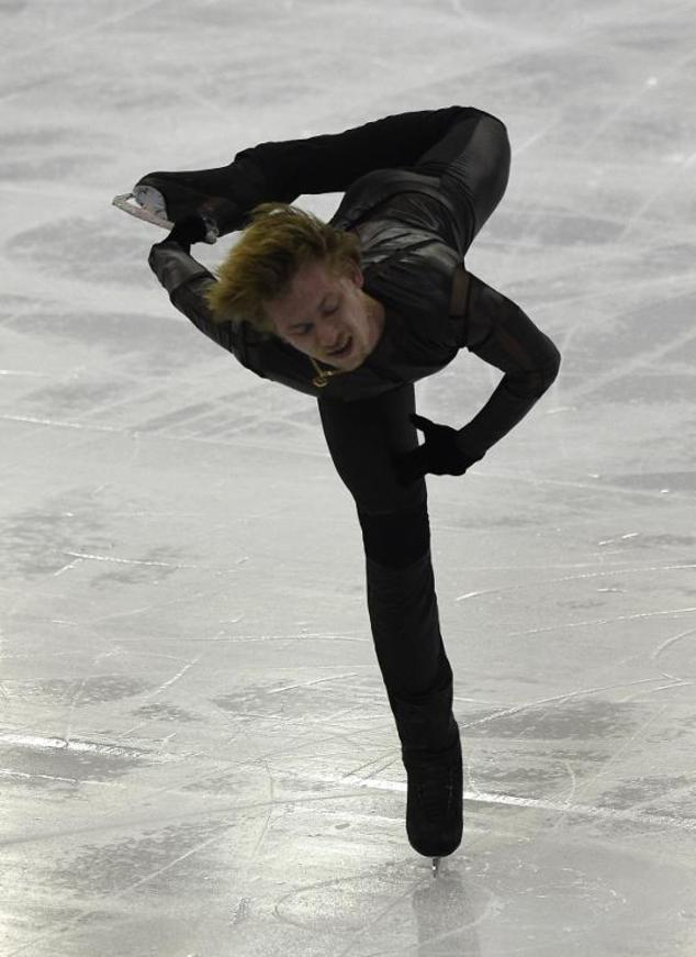 Russian Sergei Voronov perfoms during the Men Free Skating at the ISU Grand Prix of figure skating Final 2014 in the Barcelona International Convention Centr...