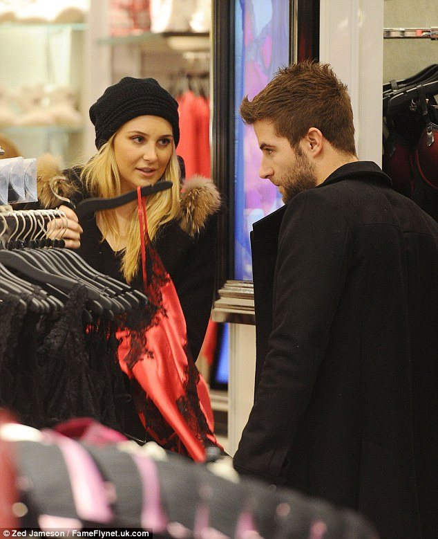 Boyfriend duties: Made In Chelsea newbie Josh considered the options as Stephanie held up sexy lingerie in store