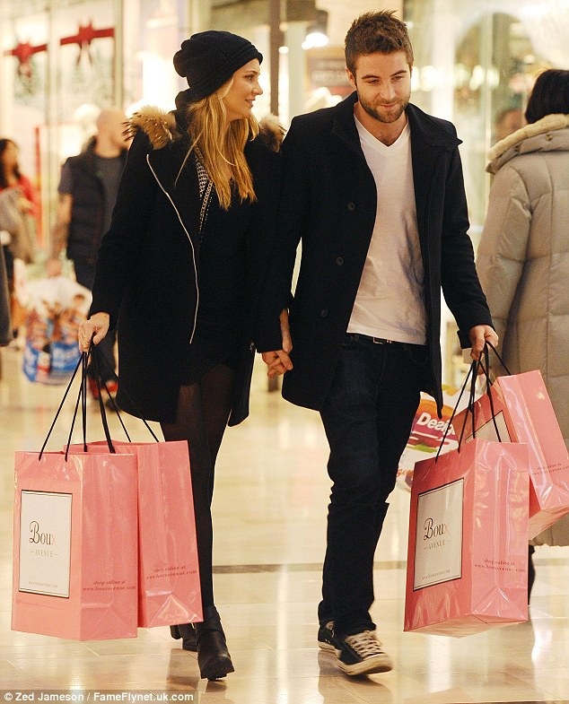 Christmas came early: Stephanie Pratt and Josh Shepherd left Westfield's Boux Avenue store carrying bags full of lingerie at the weekend