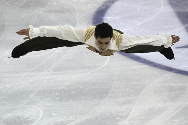 Spain's Javier Fernandez perfoms during the Men Free Skating at the ISU Grand Prix of figure skating Final 2014 in the Barcelona International Convention Cen...