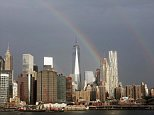epa04923908 A rainbow over the One world trade center (Freedom Tower) and lower Manhattan in New York, New York, USA, 10 September 2015.  EPA/ANDREW GOMBERT
