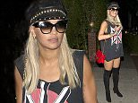 EXCLUSIVE: Rita Ora wears just a singlet top, knee high boots, a leather hat and carrying a 'Moschino' designer handbag as she arrives at a hotel in West Hollywood, CA  Pictured: Rita Ora Ref: SPL1120359  100915   EXCLUSIVE Picture by: SPW / Splash News  Splash News and Pictures Los Angeles: 310-821-2666 New York: 212-619-2666 London: 870-934-2666 photodesk@splashnews.com