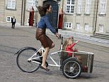 HRH Crown Princess Mary of Denmark retrieves the twins Princess Josephine and Prince Vincent from kindergarten in the cargo bike. The little Princess shows the way over the cobbles in front of Amalienborg Palace, September 2 2015. Code: 07743BS Photo: Birger Storm / All Over Press Denmark  Ref: SPL1119310  100915   Picture by: Splash News  Splash News and Pictures Los Angeles: 310-821-2666 New York: 212-619-2666 London: 870-934-2666 photodesk@splashnews.com