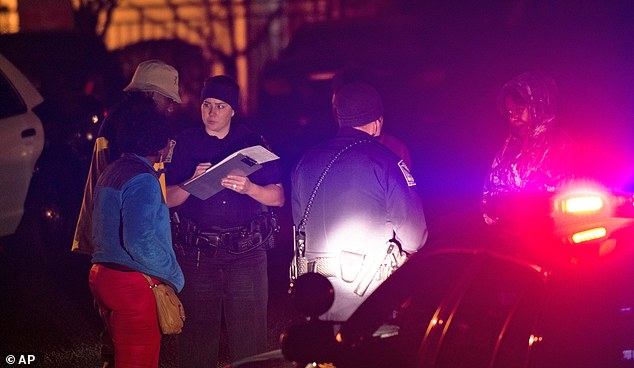 Scene: Auburn Police investigate a shooting at the Tiger Lodge apartments in Auburn, Alabama, early Sunday morning