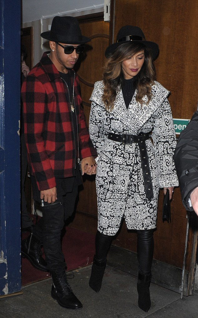 Close: Nicole and Lewis held hands as they left the theatre, not wanting to be apart for a moment