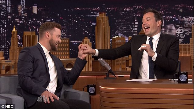 The dad club: Jimmy and Justin share a 'bro' moment