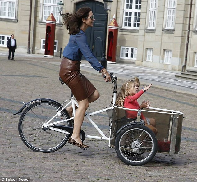 Precious cargo:Denmark's Crown Princess Mary  put on a chic sartorial display to retrieve her twin children, Princess Josephine and Prince Vincent, from Kindergarten in a classic cargo bike