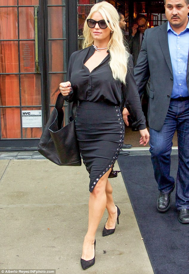 That will fire up the traders: Jessica Simpson chose a sexy lace-up pencil skirt as she left the Bowery Hotel in the East Village on a mission to open the New York Stock Exchange on Thursday morning