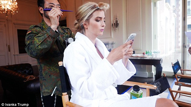 Multi-tasking: The former model responds to emails while getting glammed up for the shoot