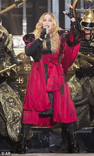 Heavy duty: Madonna's bullfighter costume appeared to have plenty of heavy layers, which must have made the star incredibly hot on-stage