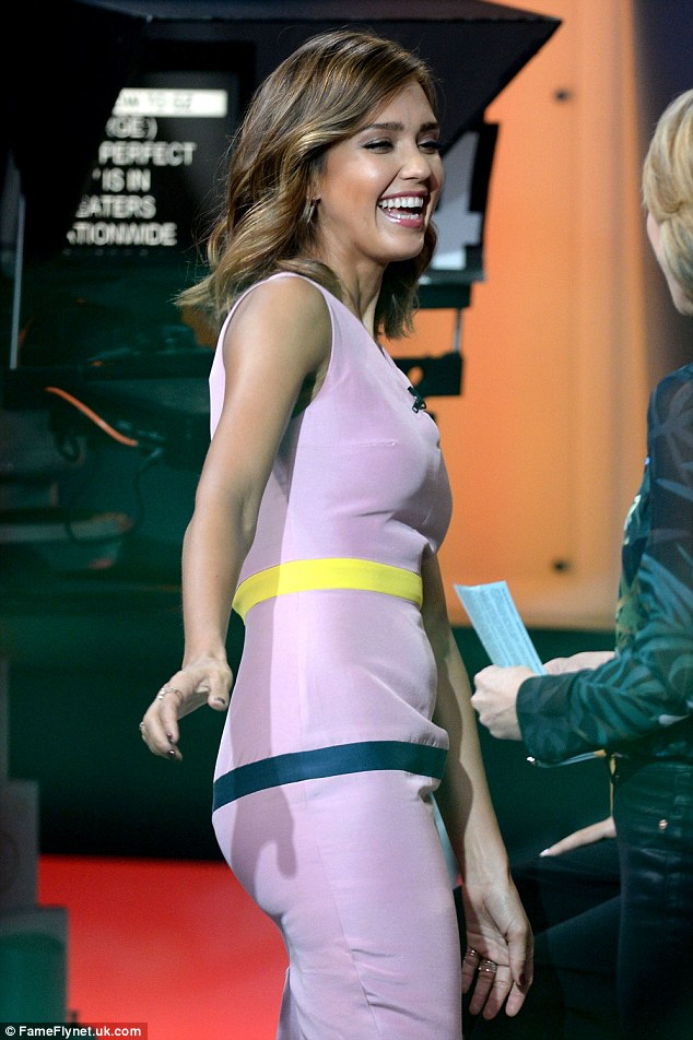 Chic and colourful: For her segment, the actress completely changes style direction donning a pale pink dress with a yellow and navy stripe running around it