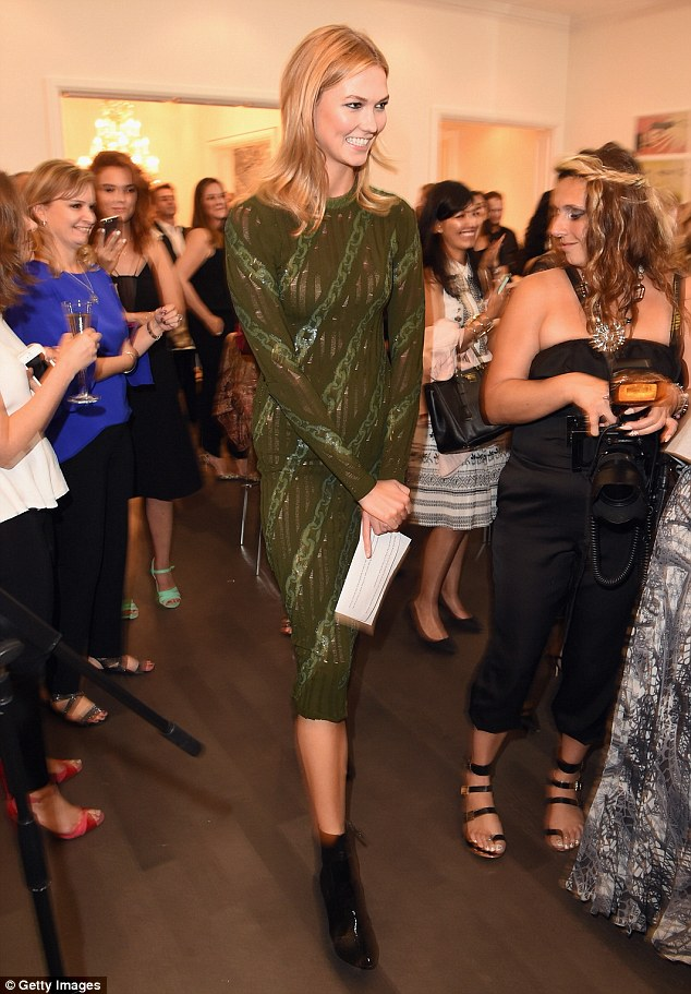 Model behaviour: The Chicago native flashed some leg in the calf-length dress at the VIP bash, while adding height to her already statuesque 6ft 1in frame with a pair of pointed black patent ankle boots