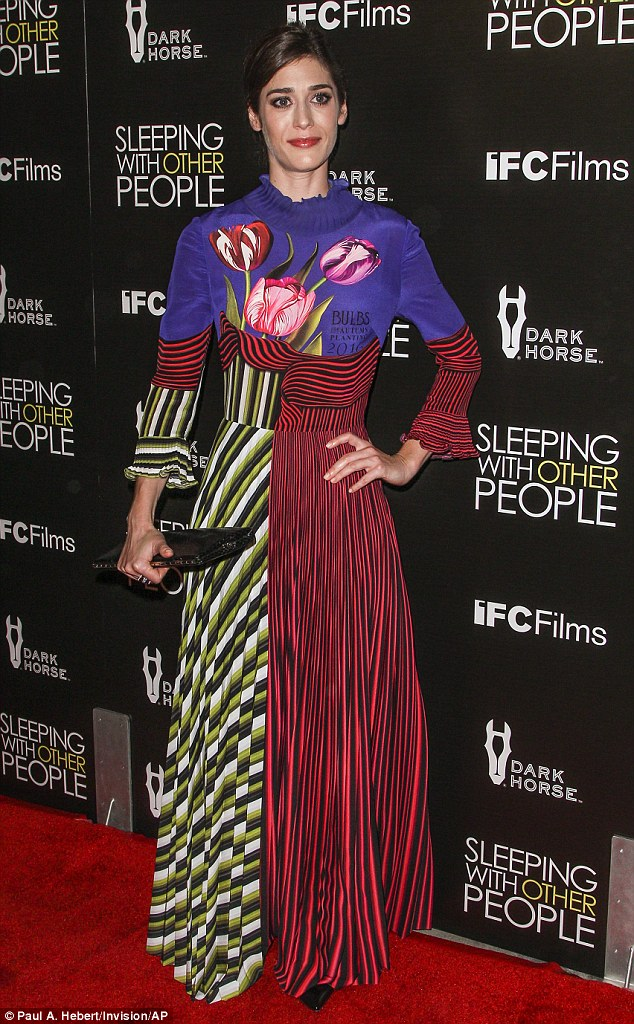 Statement dress: Kaplan, 33, wore an attention-grabbing full-length gown that featured stripes, patterns and a tulip motif in a variety of colors
