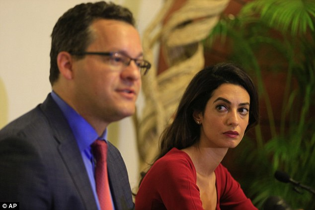 A force to be reckoned with: Amal addressed the media withJared Genser