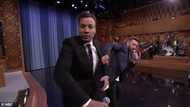 Getting carried away: Jimmy got too much into character and almost attacked the cameraman during the N.W.A segment