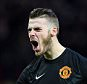 MANCHESTER, ENGLAND - DECEMBER 14:  David De Gea of Manchester United celebrates the first goal during the Barclays Premier League match between Manchester United and Liverpool at Old Trafford on December 14, 2014 in Manchester, England.  (Photo by Shaun Botterill/Getty Images)