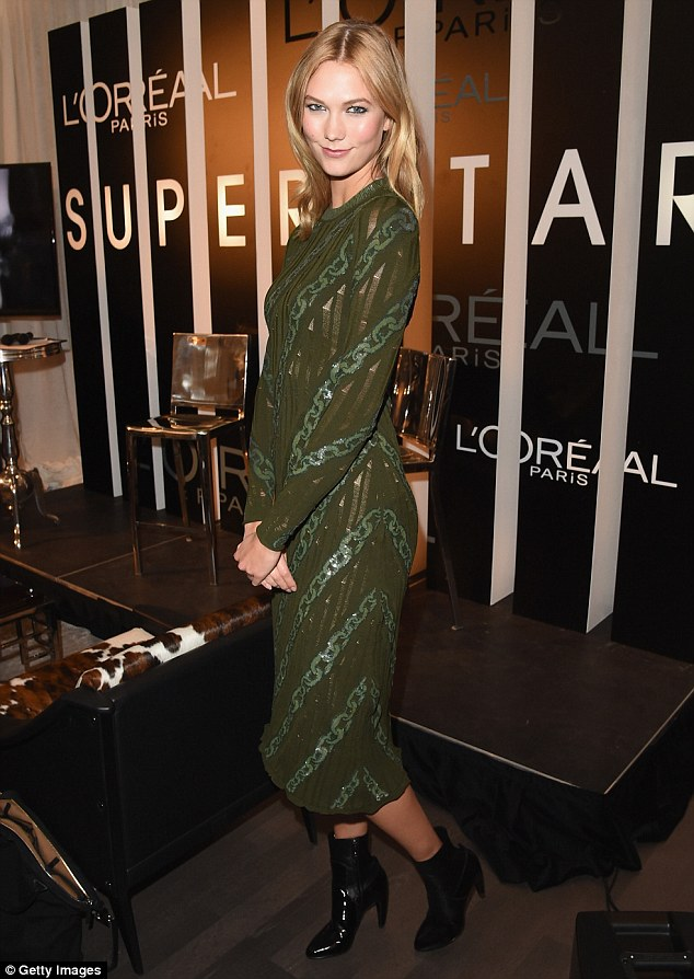 Flawless frame: The former Victoria's Secret Angel - who's a Brand Ambassador for beauty brand L'Oreal - flaunted her gym-honed physique as she posed up a storm at the Trump International Hotel & Tower in Canada