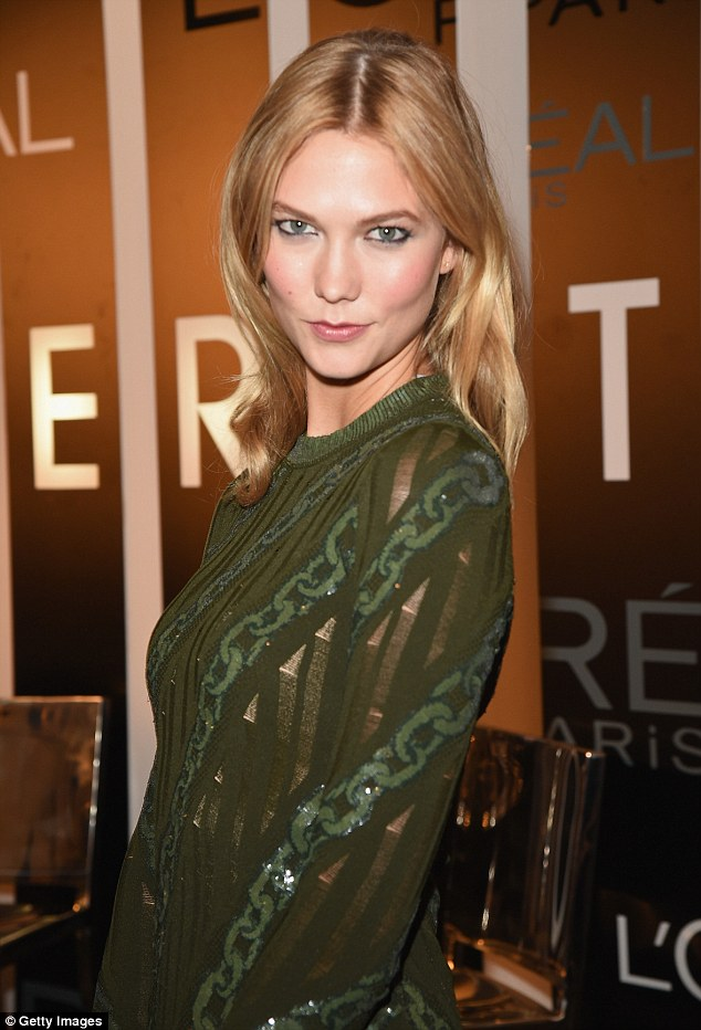 Natural beauty:Her blonde locks were styled into a relaxed centre-parting, her famous 'Karlie' bob appearing to have grown out into a chic, shoulder-length hairstyle