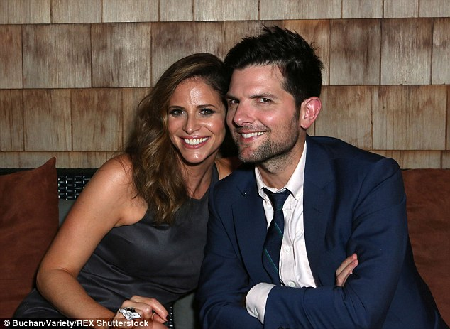 Off screen pals: Adam looked pleased to catch up with his co-star Amanda Savage at the bash
