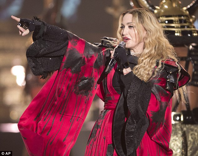 Flamboyant: The Material Girl was uncharacteristically covered up in the red and black bullfighter traje de luces costume - one of eight different looks during the show - designed by Spanish tailors Zaragoza