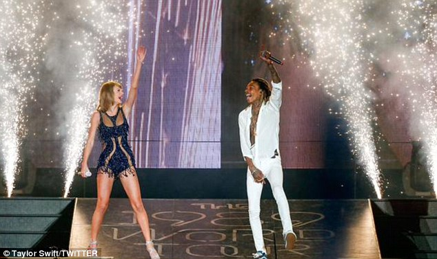 'That bond will never be broken': Swift and the Taylor Gang rapper performed his hit song See You Again