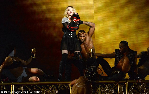 Defenceless: The singer - who's thebest-selling female recording artist of all time - looked to be tied up by her dancers at one point in the show