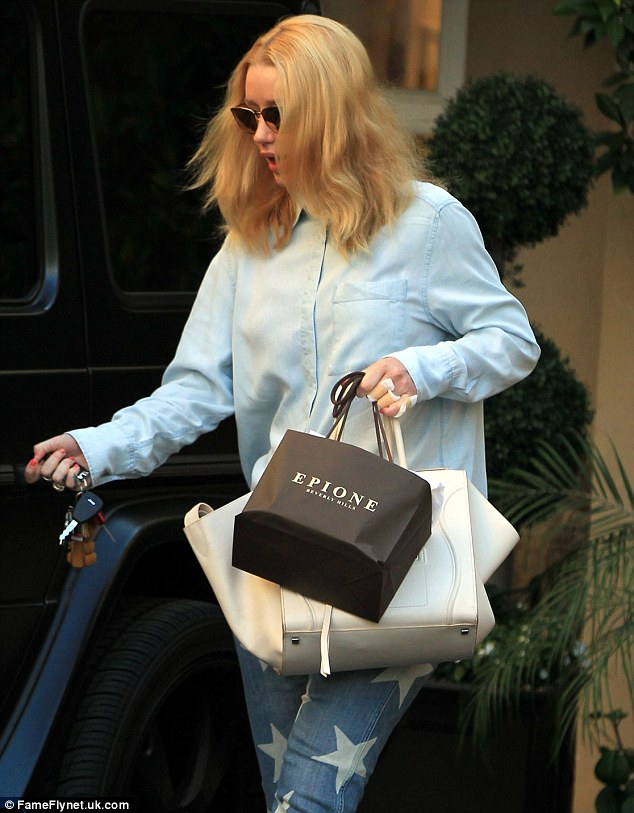 She's got baggage:The Fancy hit-maker carried a small bag from Epione, a Beverly Hills based cosmetic surgery specialist offering treatments including laser removal surgery, liposuction and Botox