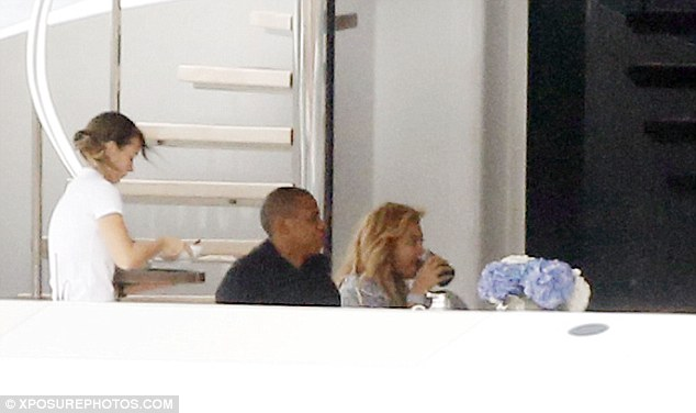 Special treatment: Beyonce was seen sipping on a cold beverage while the power couple were served food by on board staff